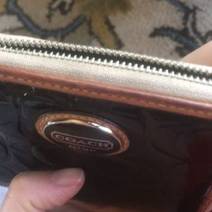 Coach Bags - Coach patent black/tan leather zip around wallet